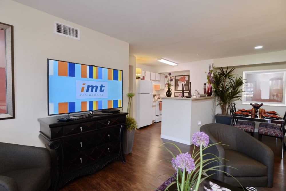 Open-concept floor plan, showcasing hardwood floors and modern decor in model home at IMT At The Medical Center in Houston, Texas