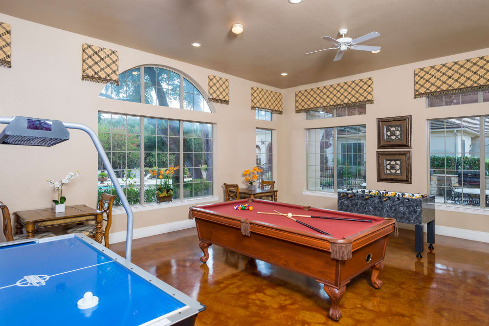 Resident clubhouse with a game room at Villas of Vista Del Norte in San Antonio, Texas