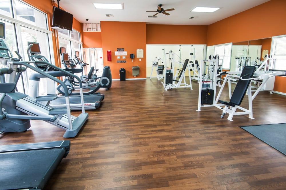The well-equipped fitness center at Villas of Preston Creek in Plano, Texas