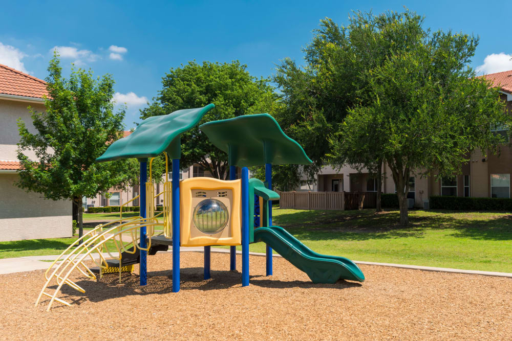Another view of the onsite playground at Villas of Preston Creek in Plano, Texas