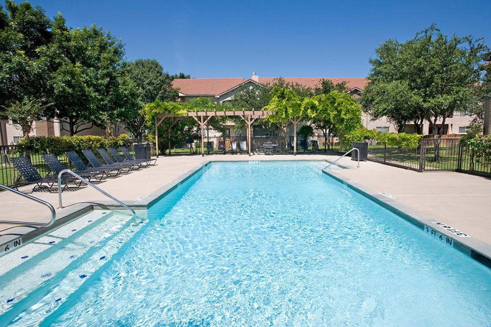 Beautiful swimming pool at Villas of Preston Creek in Plano, Texas