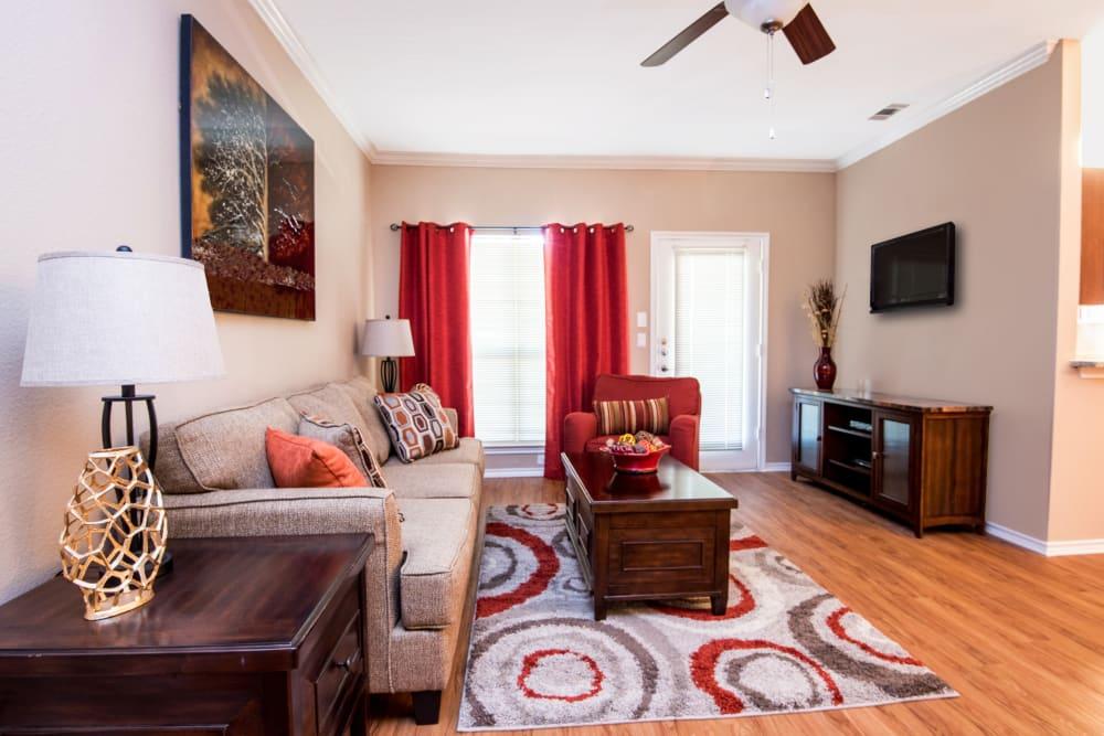A bright and spacious living room at Villas of Preston Creek in Plano, Texas