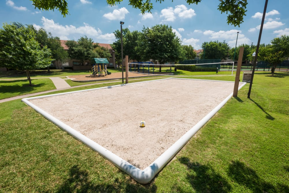 The beach volleyball court at Villas of Preston Creek in Plano, Texas