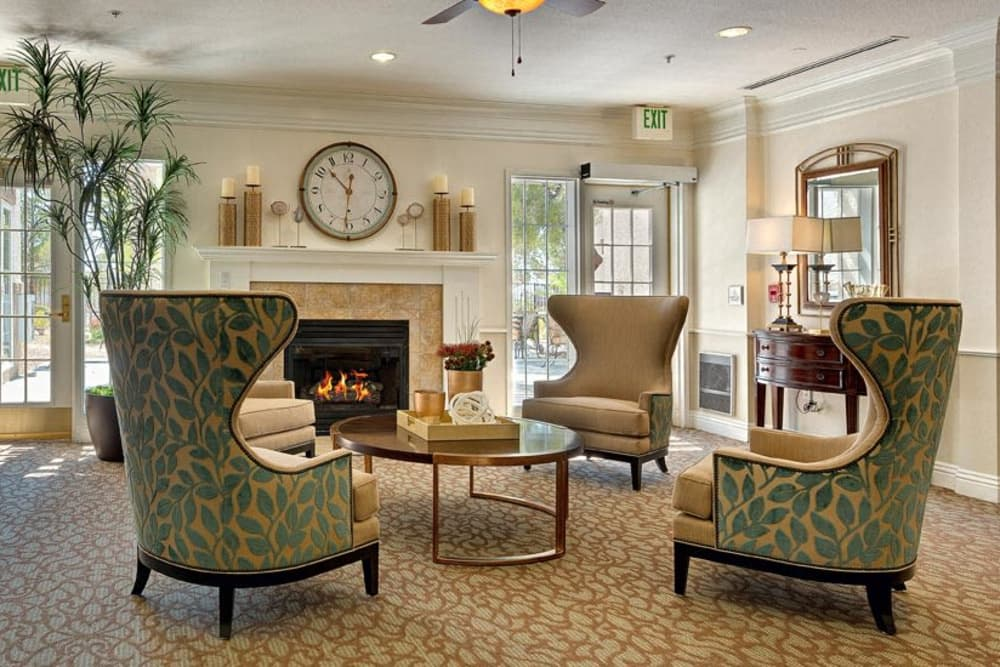 Spacious living room with fireplace at Heritage Springs in Las Vegas, Nevada
