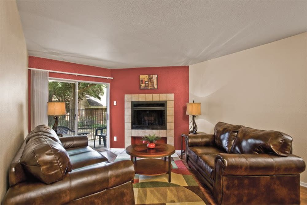 Spacious living room at Fountains at Steeplechase Apartments in Plano, Texas