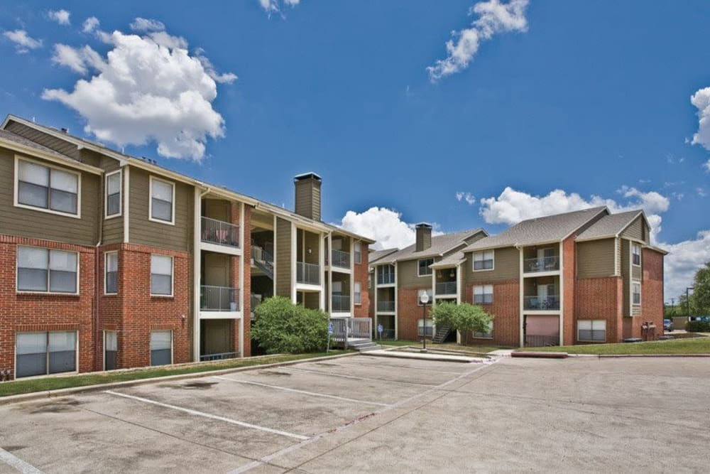 Exterior view of our apartments at Fountains at Steeplechase Apartments in Plano, Texas