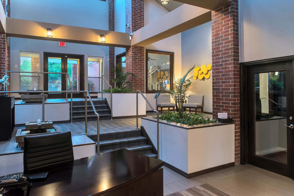 Clubhouse entrance at Fountains at Steeplechase Apartments in Plano, Texas