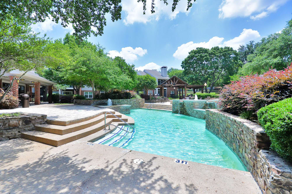 Beautiful swimming pool at Fountains at Steeplechase Apartments in Plano, Texas