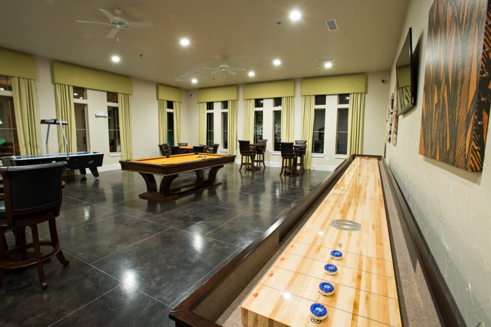 Shuffleboard and more in the game room at Villas in Westover Hills in San Antonio, Texas