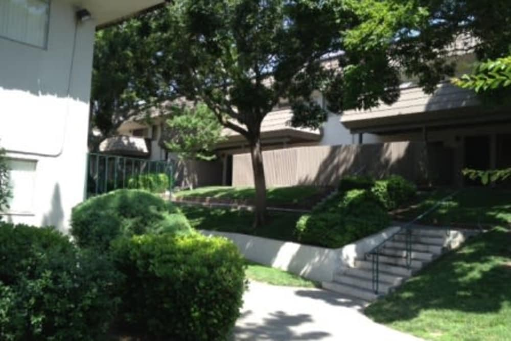 Landscaped grounds around Hacienda Apartments in Sacramento, CA