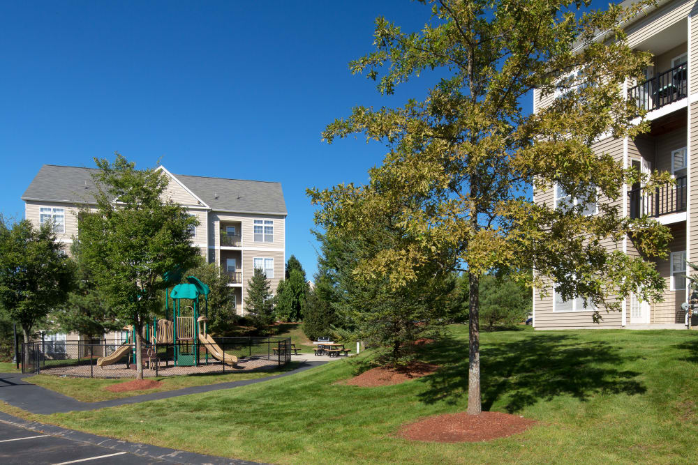 Well-manicured lawn and landscaping amid resident buildings at Prynne Hills in Canton, Massachusetts