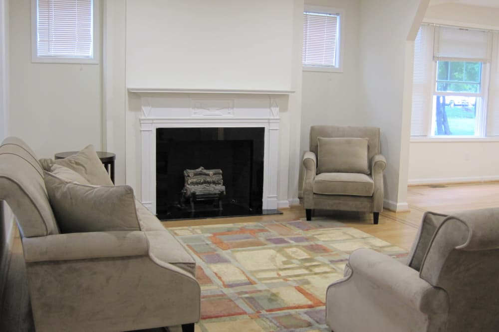 Living room with fireplace at CHAI Hoped in Baltimore, Maryland