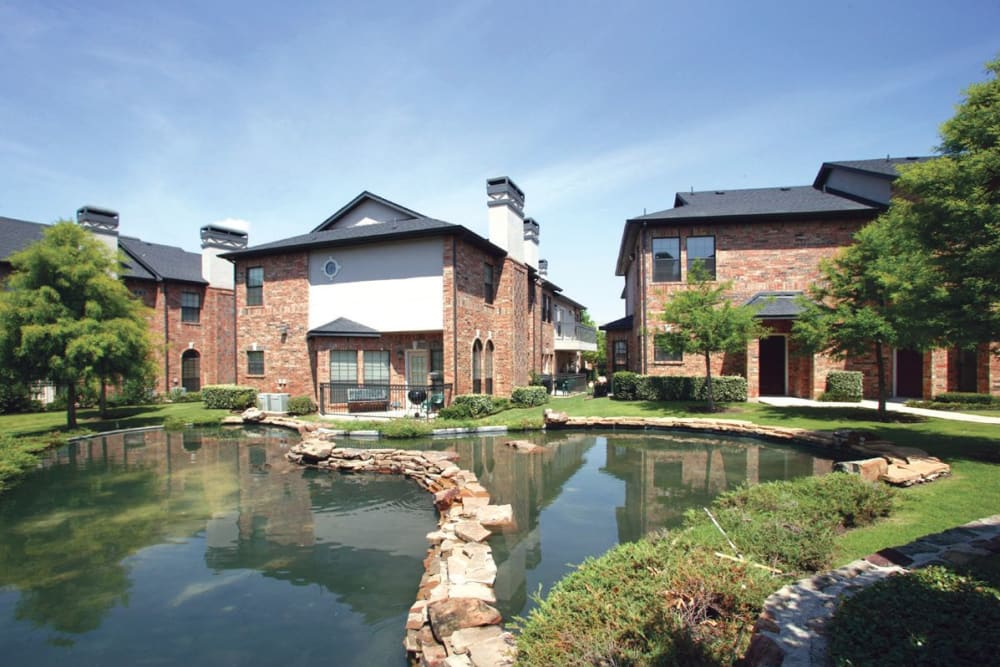A creek in front at house at Villas at Parkside in Farmers Branch, Texas