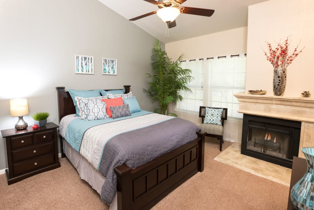 Comfortable bedroom at Villas at Parkside in Farmers Branch, Texas
