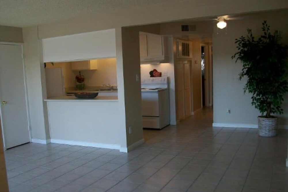 Dining and living room at Villa del Rio Apartments in Sacramento, CA