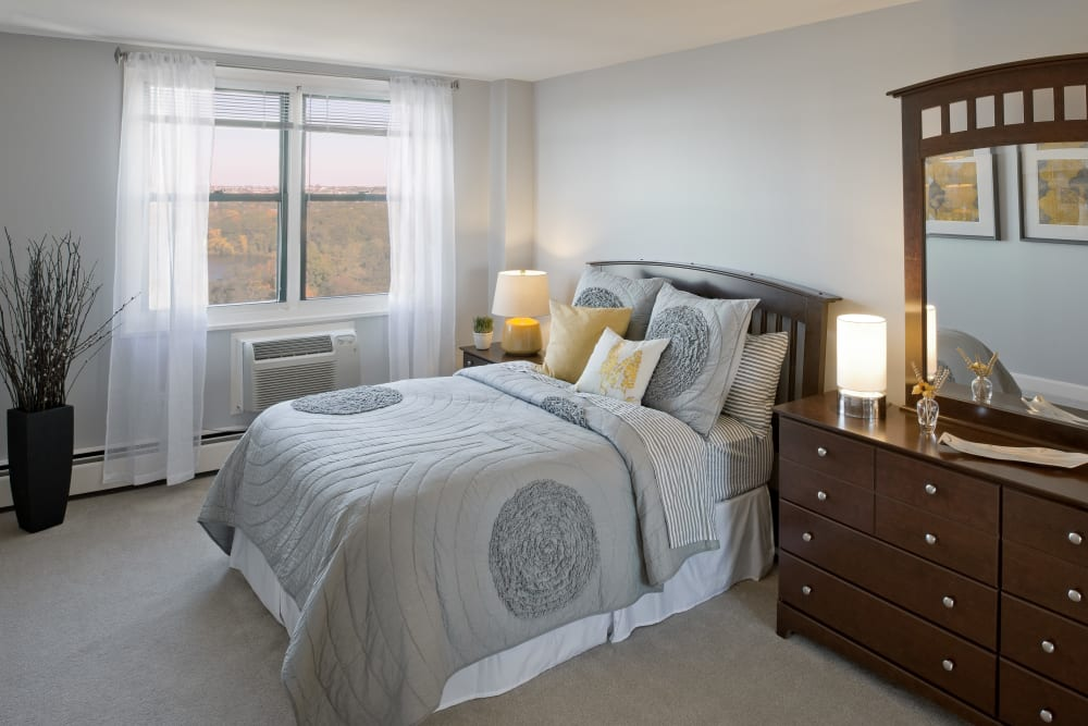 Tastefully decorated model bedroom at Parkside Place in Cambridge, Massachusetts