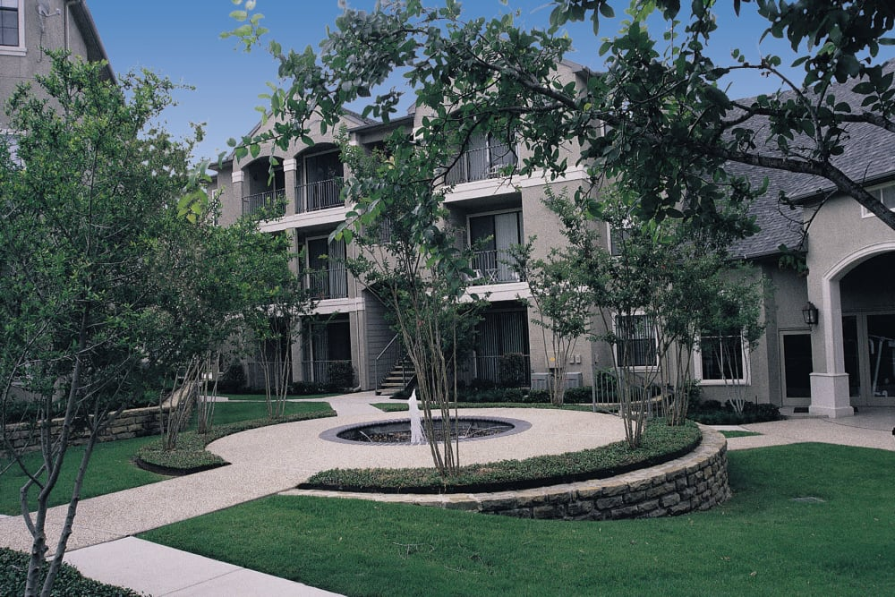 A beautifully landscaped area with a water feature at Briargrove at Vail in Dallas, Texas