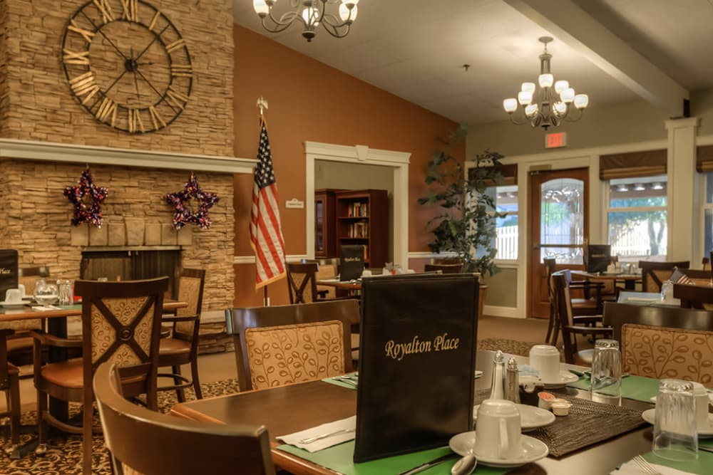 Dining area with fireplace at Royalton Place in Milwaukie, OR