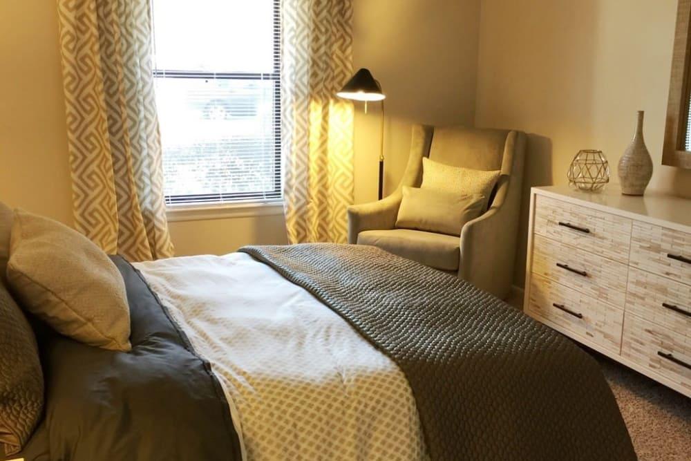 Cozy bedroom at apartments in Charlotte, North Carolina