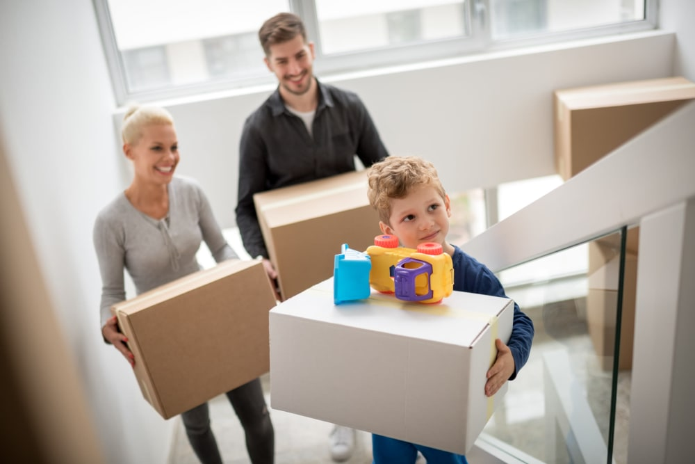 Family moving with boxes purchased at Keystone Self Storage in North Miami, Florida