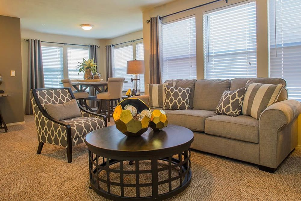 Beautiful, bright living room at Icon at Broken Arrow in Broken Arrow, Oklahoma