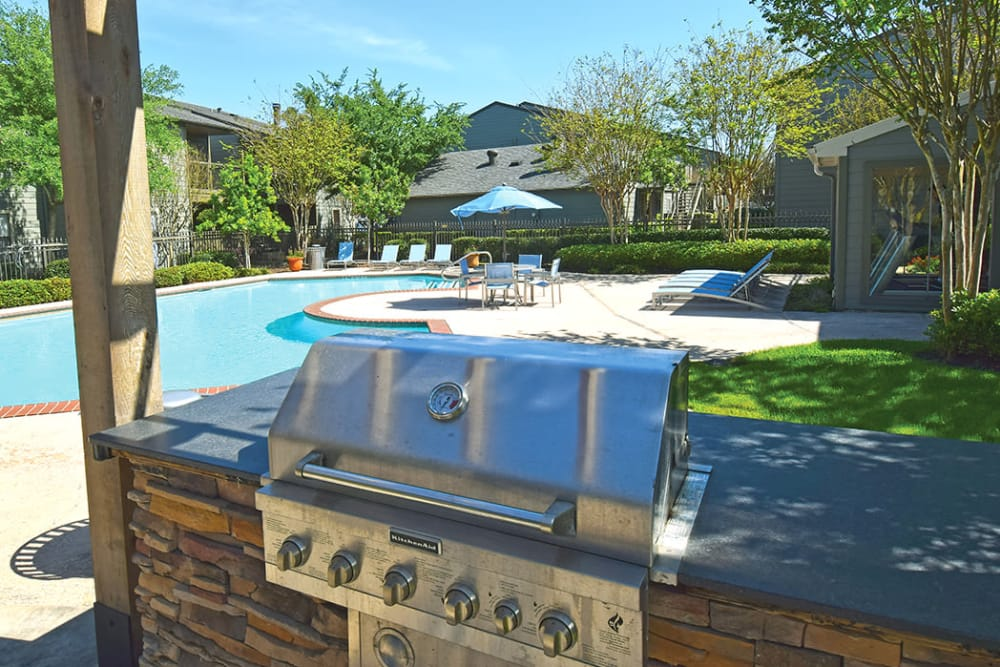 BBQ area near swimming pool at The Lodge on El Dorado in Webster, Texas