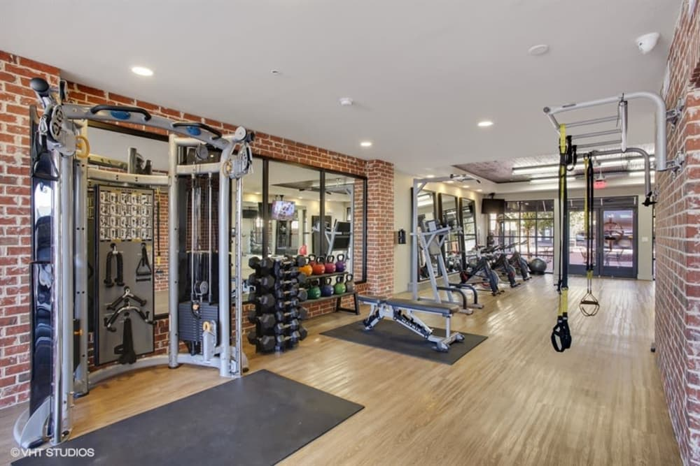 Modern fitness center at apartments in Plano, Texas