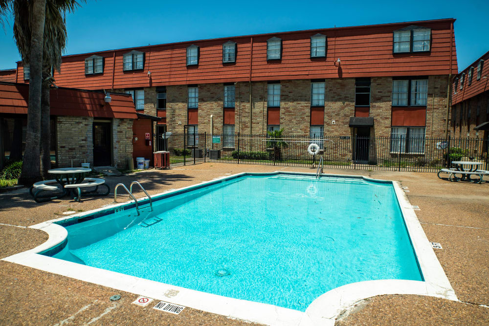 Swimming pool at Maple Trail Apartments & Townhomes in Pasadena, Texas