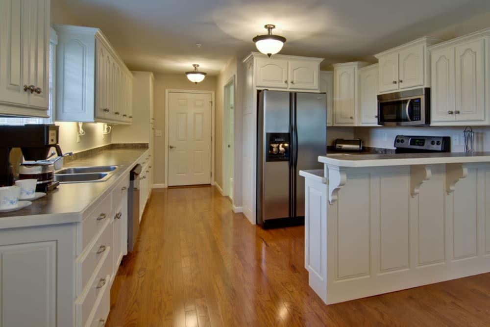 Kitchen with hardwood floors at Capetown Senior Living in Cape Girardeau, Missouri