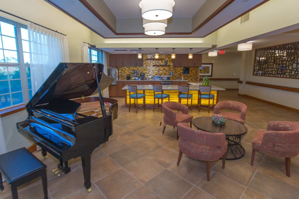 resident lounge with a bar and piano