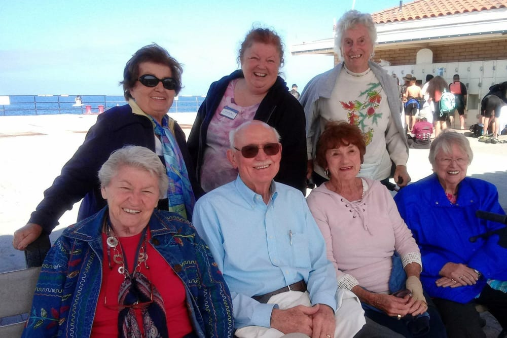 Residents relaxing at the beach from our senior living community in Huntington Beach, CA