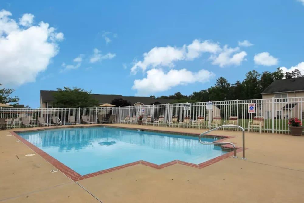 A large swimming pool with a sundeck at Timber Ridge in Fredericksburg, Virginia