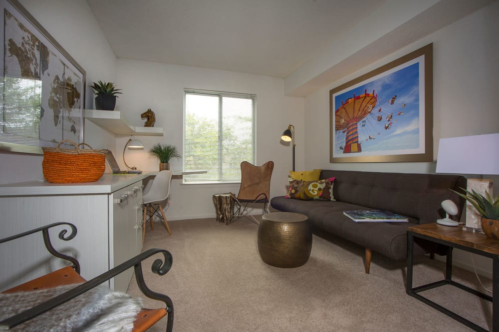 Comfy living room at Briar Cove Terrace Apartments in Ann Arbor, Michigan