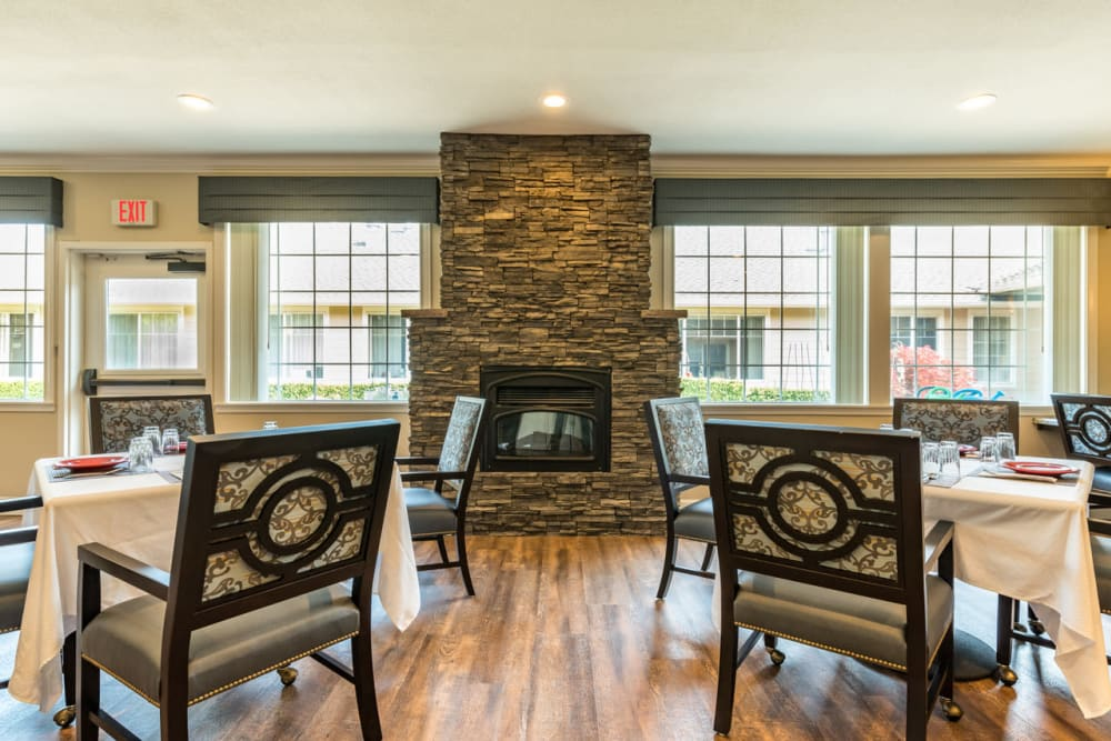 Sip hot cocoa by our Pacifica Senior Living McMinnville fireplace