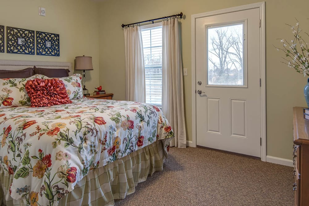 Bedroom with a large bed at La Bonne Maison Senior Living in Sikeston, Missouri