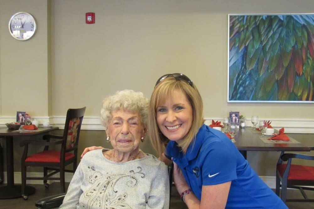 senior resident and young woman smiling