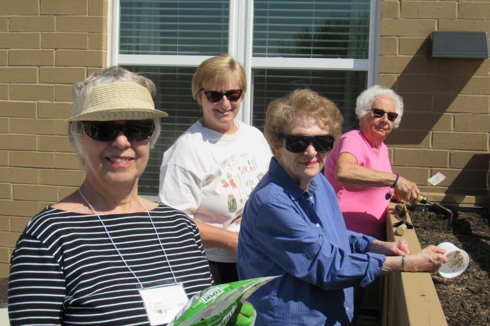 group of residents enjoying the sunshine