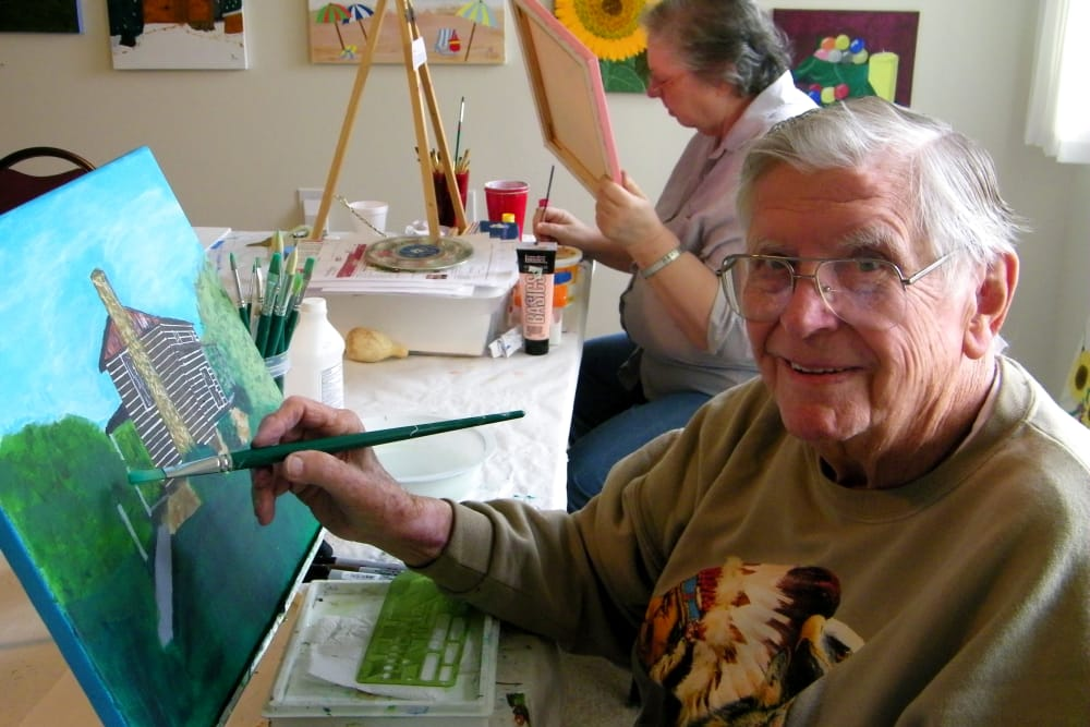 A senior man painting a house at Hawthorn Senior Living in Vancouver, Washington