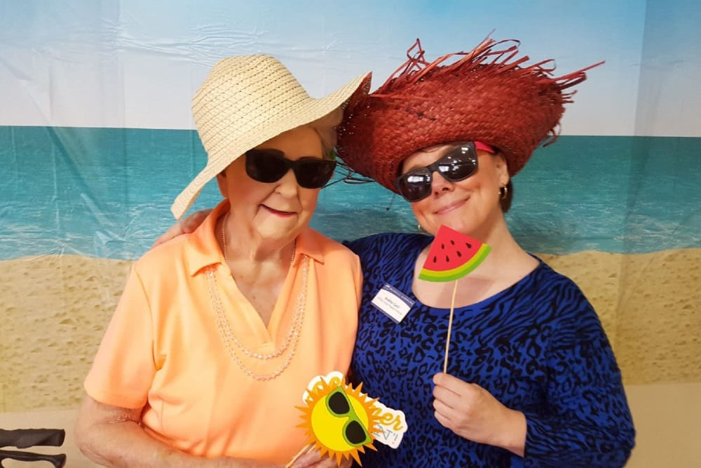 two senior women wearing fun hats at Merrill Gardens at Siena Hills in Henderson, Nevada