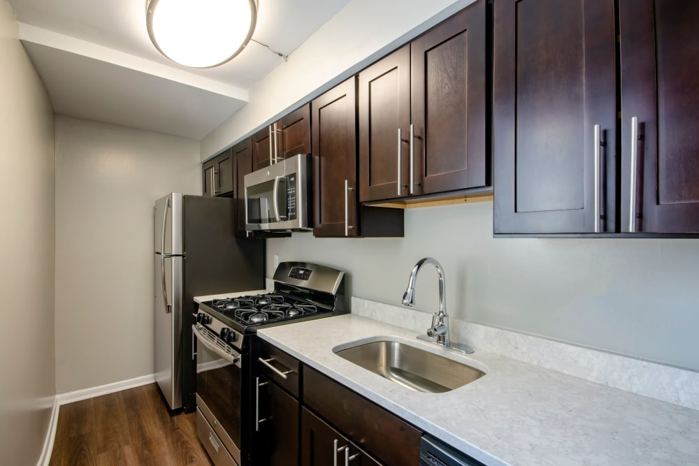 Dark wood kitchen cabinetry at The Warwick Apartments