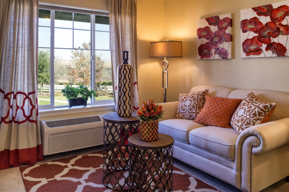 Living room with window at The Commons at Union Ranch in Manteca, California
