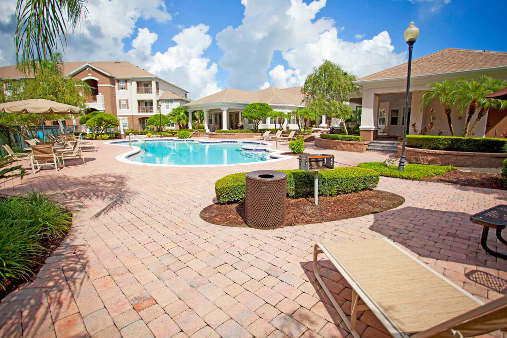 Swimming pool and outdoor community area at Legends Winter Springs in Winter Springs, Florida