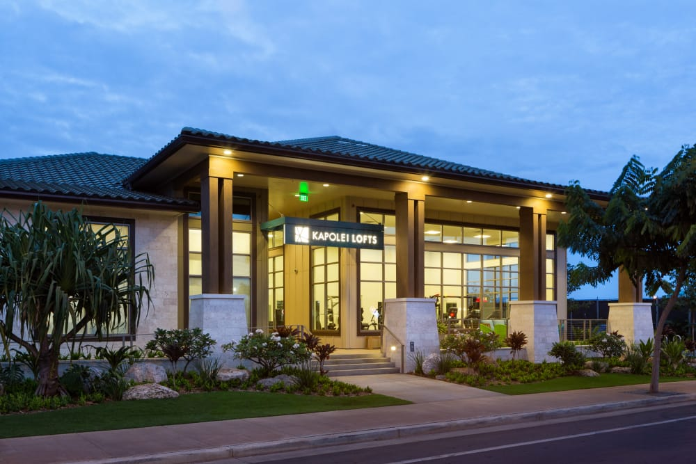 Exterior view of the leasing office at dusk at Kapolei Lofts in Kapolei, HI