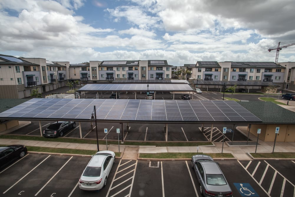 Solar panels above the covered parking structures and on rooftops at Kapolei Lofts in Kapolei, HI
