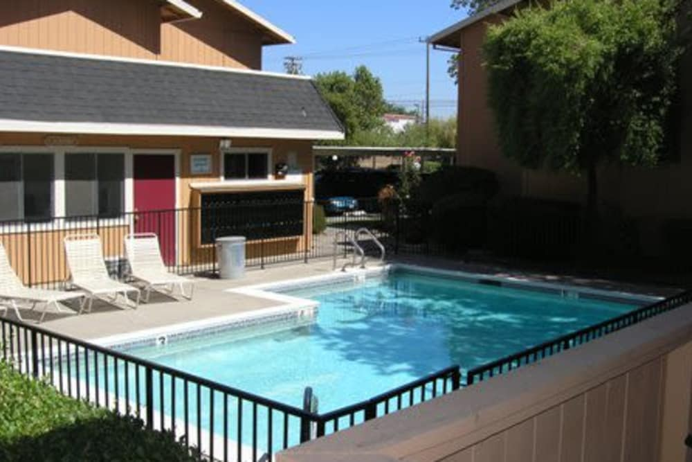Apartment home next to swimming pool at Arden Bell Apartments in Sacramento, California