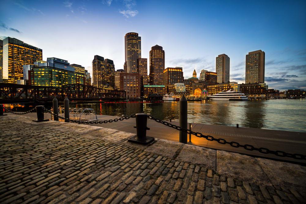 City skyline at dusk near 244 Hanover Apartment Homes in Boston, MA