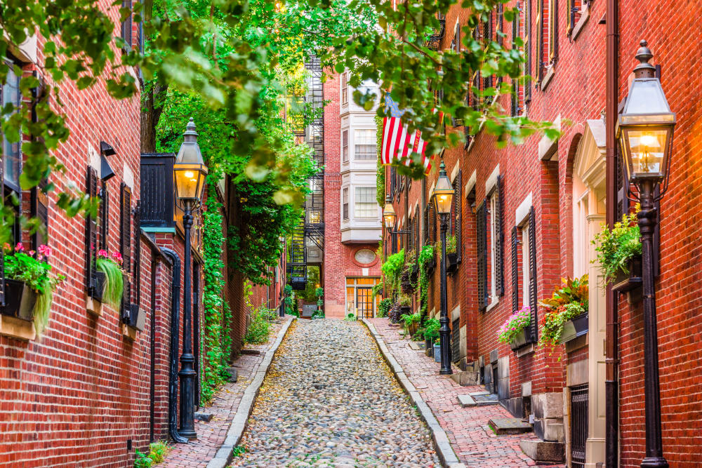 Beautiful cobblestone alley between brick buildings near 244 Hanover Apartment Homes in Boston, MA