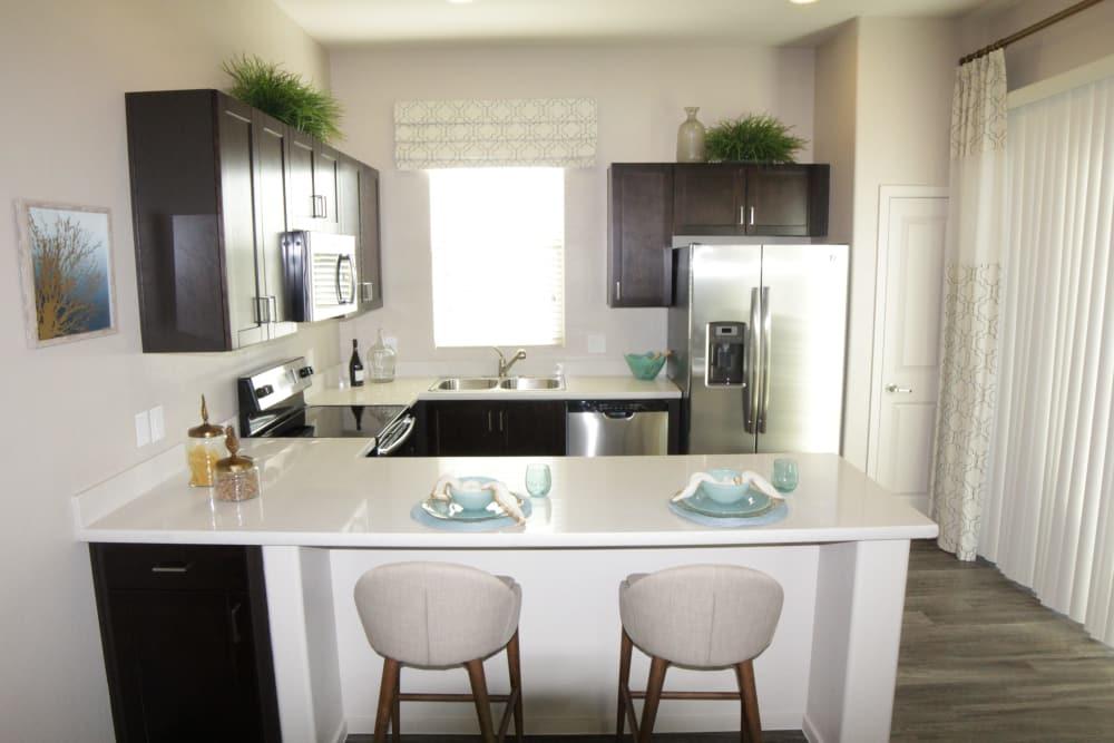 Luxury kitchen with breakfast bar at Avilla Victoria in Queen Creek, Arizona