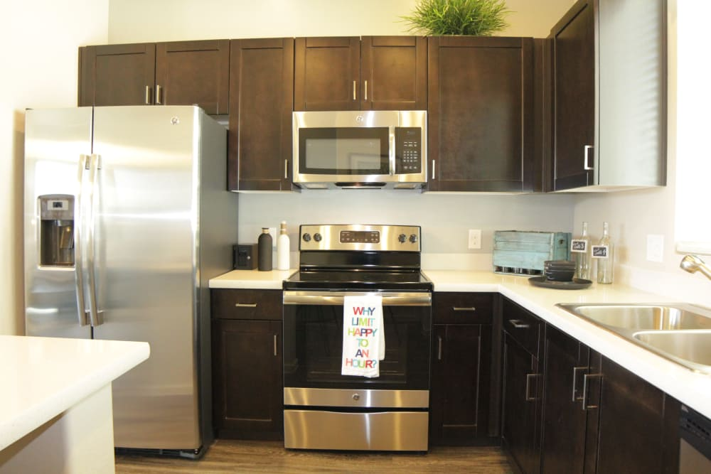 Enjoy a well-equipped kitchen at Avilla Victoria in Queen Creek, Arizona