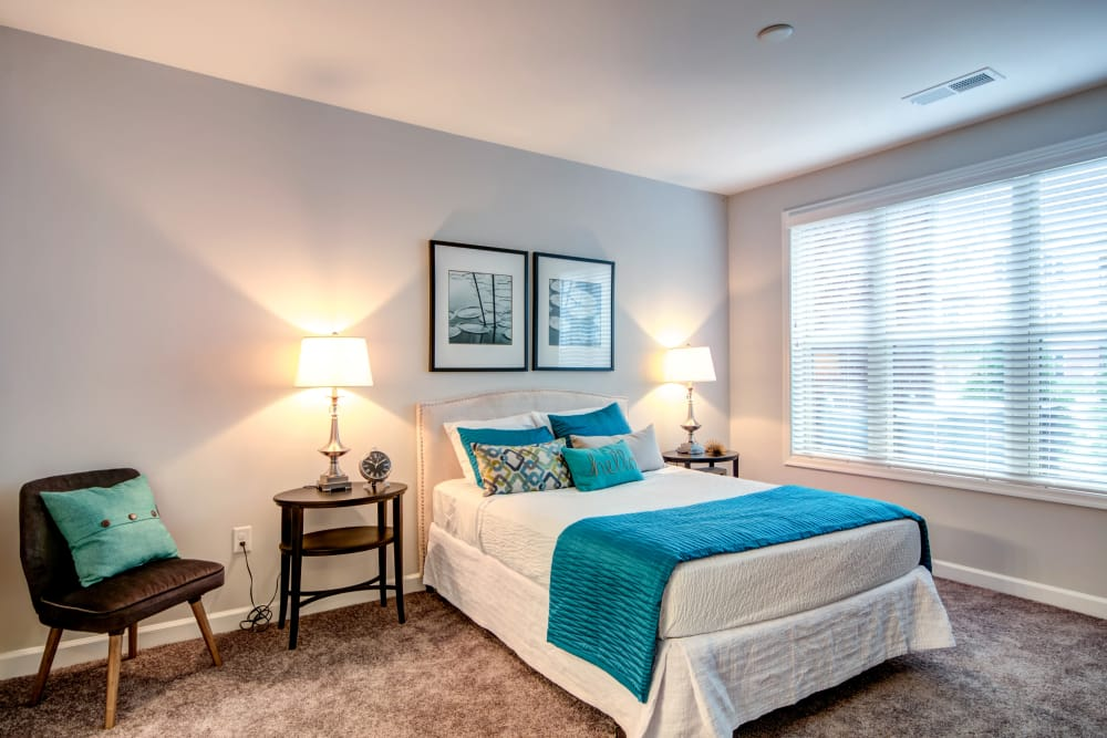 Bedroom with blue accents at Manassas Station Apartments in Manassas, Virginia